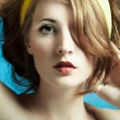 Portrait of the young woman on blue background - Foto de Stock  