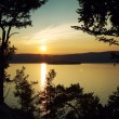 Night landscape against a decline lake Baikal - Stock Photo