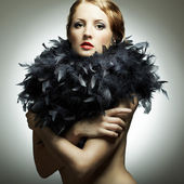 Portrait of the young woman from a boa — Stock Photo