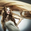 Portrait of the young woman against a flying fabric — Stock Photo #3863106