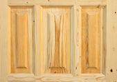 Fragment wooden door made of coniferous tree — Stock Photo