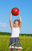 The little girl on the lawn — Stock Photo