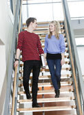 Couple walk the stairs — Stock Photo