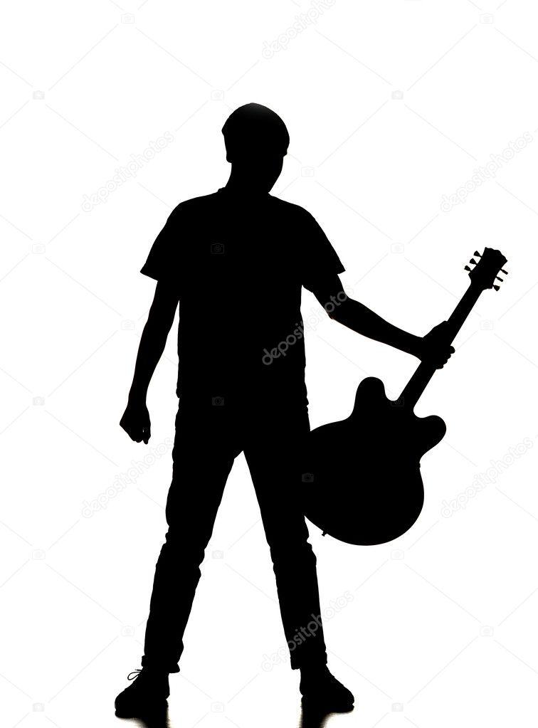 一个人弹吉他的轮廓– 图库图片