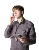 Young man with telephones — Stock Photo