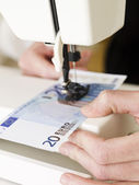 Sewing a Euro bank note — Stock Photo