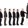 Men in line — Stock Photo