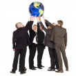 Group of men holding a terrestrial globe — Stock Photo