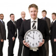 Business Manager with a clock - Stock Photo