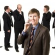 Man on the phone in front of his team — Stock Photo