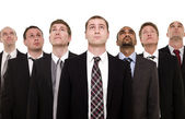 Confident team looking up — Stock Photo
