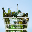 Stock Photo: Glass bottles in wastebasket
