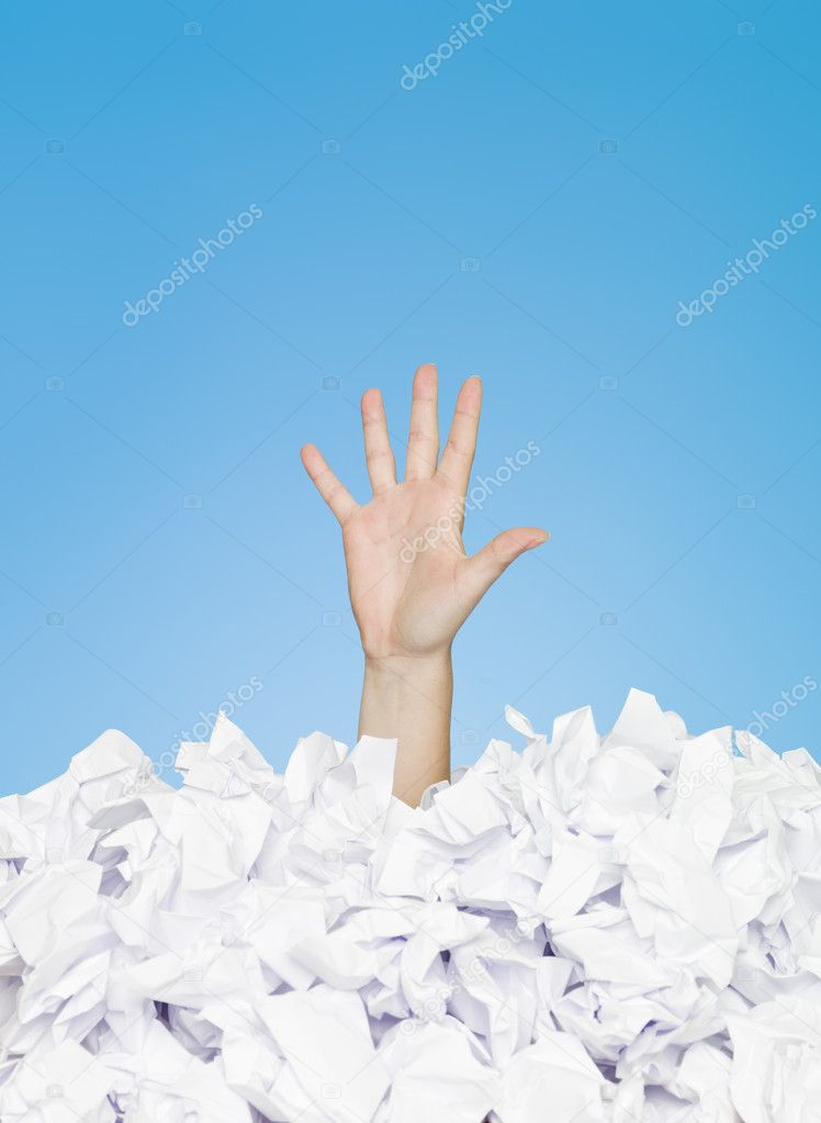 Human hand buried in papers — Stock Photo #3294288
