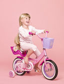 Girl on her bike — Stock Photo