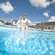 Mother and daughter at the swiiming pool — Stock Photo #3709148