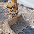 Vertical of digger bucket - Foto Stock