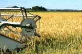 Harvester and barley — Stock Photo