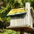 Old wooden bird house — Stock Photo