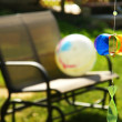 Pinwheel and loveseat in the backyard - Stock Photo
