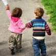 Toddlers walking away holding hands — Stock Photo