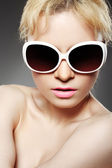 Fashion woman with big white sunglasses — Stock Photo