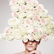 Beautiful woman with a rose headwear in a model pose - Stock Photo