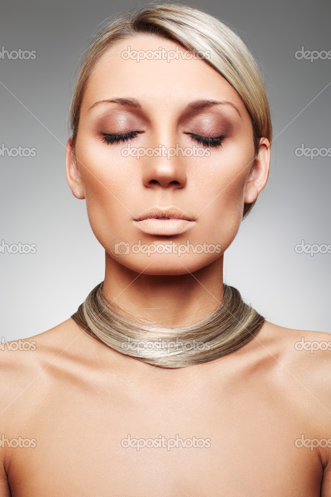 Luxury woman with natural chocolate make-up and beautiful shiny blond hair on gray background.  Stock Photo #3259892