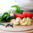 Vegetables on wooden board, focus on pepper — Foto de Stock