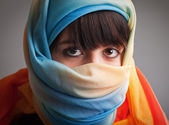 Young woman in colorful headscarf — Stock Photo