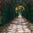 Archway in the garden in autumn. — Stock Photo