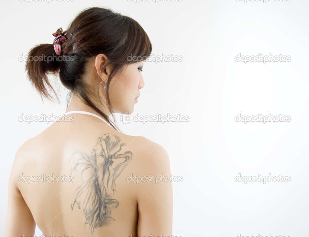 metal wing tattoos on back