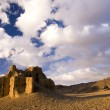 Sunset of old castle in desert — Stock Photo