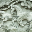 Stock Photo: Carving on buddhism temple wall