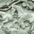 图库照片: Carving on buddhism temple wall