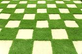 Beautiful grass tiles in a garden — Stock Photo