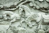 Carving on buddhism temple wall — Stock Photo