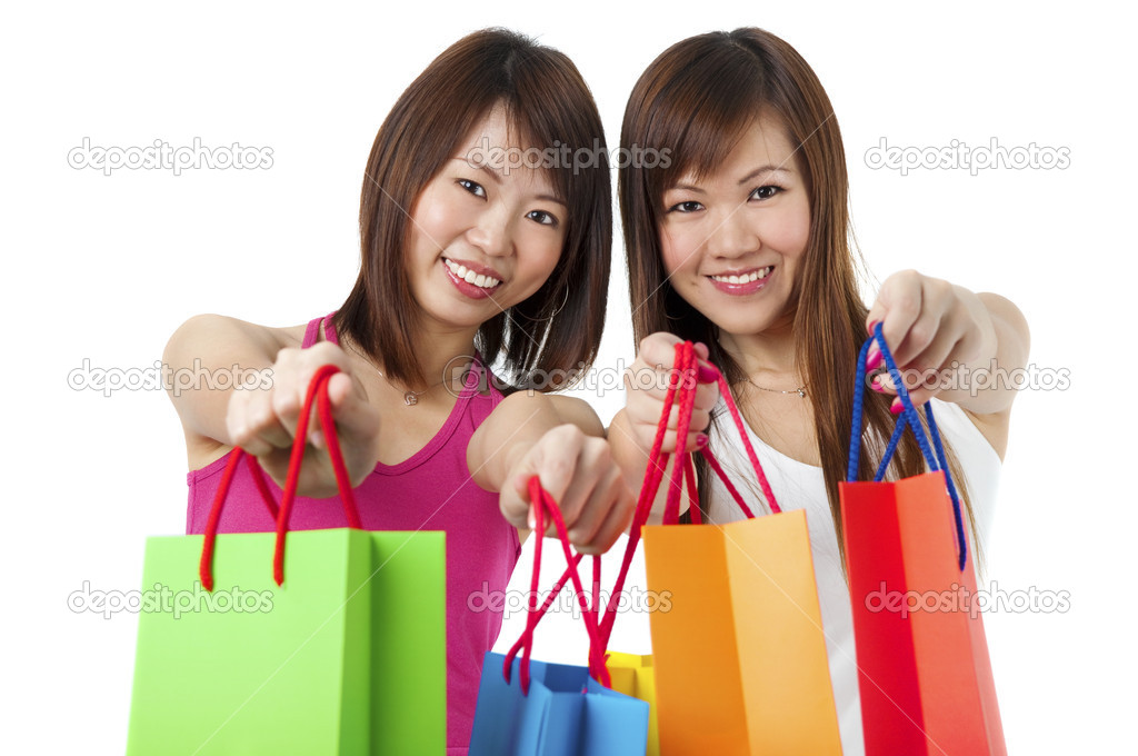 Happy Asian girls showing their shopping bags against white background. — Stock Photo #2905793