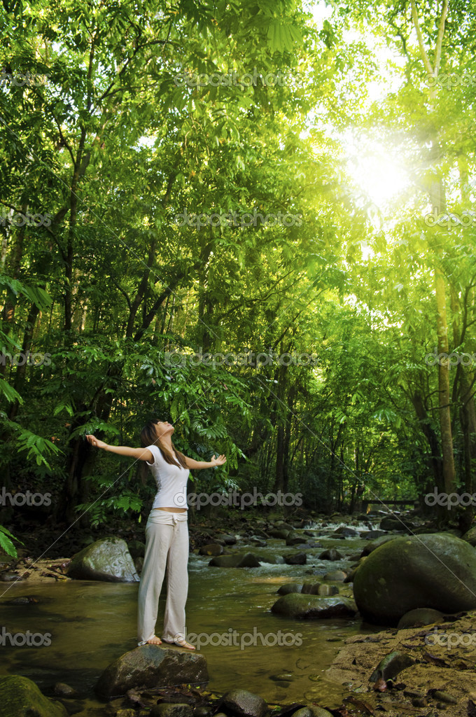 Young woman arms opened enjoying the fresh air in tropical green forest — Stock Photo #3067979