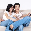 Enjoying TV show — Stockfoto