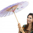 Portrait of a woman with kebaya with umbrella on white background — Stock Photo #3873335