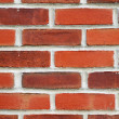 Close up view of a red brick wall — Stock Photo #2774815