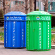 Two recycle bins for paper and bottles — Stock Photo