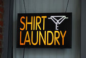 A neon sign of the shirt laundry shop — Stock Photo