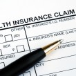 Filling the health insurance claim form — Stock Photo