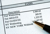 A list of withholding taxes — Stock Photo