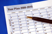 Planning the year on the day planner — Stock Photo