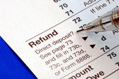 Getting refund from the tax return — Stock Photo