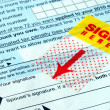 Do not forget to sign the tax return - Stock Photo