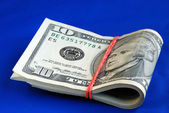 A strap of ten dollar bills — Stock Photo