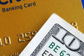 Ten dollar bill and a credit card — Stock Photo
